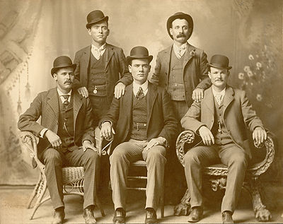 Front row left to right: Harry A. Longabaugh, alias the Sundance Kid, Ben Kilpatrick, alias the Tall Texan, Robert Leroy Parker, alias Butch Cassidy; Standing: Will Carver, alias News Carver, & Harvey Logan, alias Kid Curry; Fort Worth, Texas, 1900.